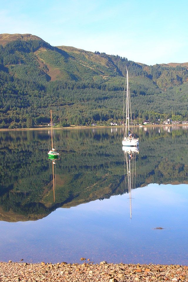 Boats moored on Loch Duich, Lochalsh at the Kintail Lodge Hotel