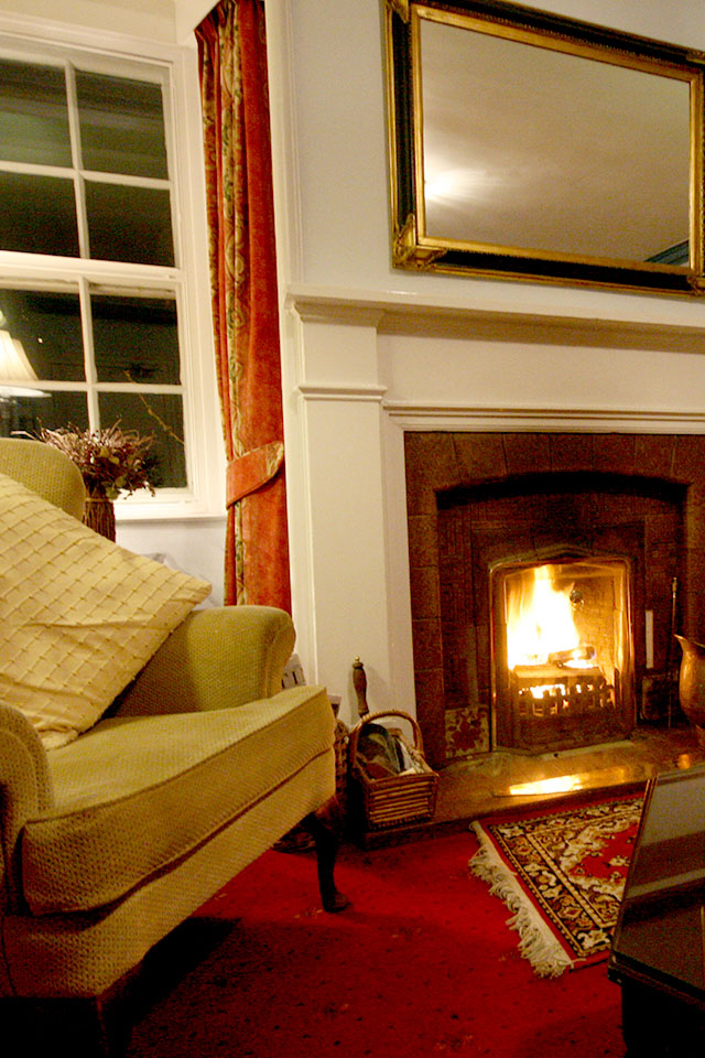 Roaring log fire in the wee sitting room at Kintail Lodge Ross-shire